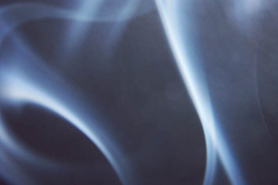 Swirling smoke on a dark background.