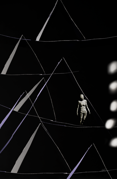 A dark scene with a roughly sculpted female body amid an abstract, contrasty house of cards. The colors are black and purple.